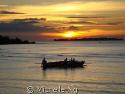 Sunset at the Kima Bajo village, Manado. Fishermen starte... by Michelle Ng