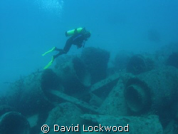 """Jumbled Wreck"". Exploring the concrete pipes laid aside ... by David Lockwood"