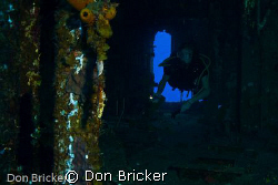 My son exploring the inside of the HMS Tibbet off the coa... by Don Bricker