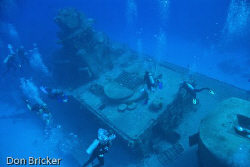 The dive boat anchored above the Tibbets and everyone des... by Don Bricker