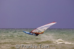 Windsurfer off beach of Kota Kinabalu, Sabah, Malaysia by Frankie Tsen