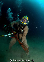 US Navy diver with a small wrench. by Andrew Mckaskle