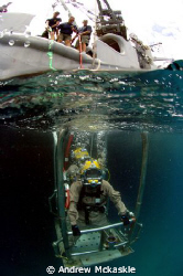 US Navy Divers going to the office. by Andrew Mckaskle