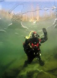 A shot taken during my first diving under ice. I think, t... by Alena Vorackova