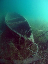 Small wreck of a boat on large Austrian lake Attersee.  by Alena Vorackova