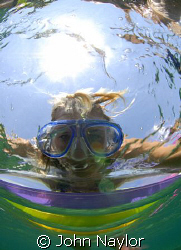 girl on a lilo.I was snorkeling and took this shot of my ... by John Naylor
