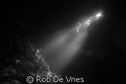 "Sunlight in a cave in ""the passage"" Rajah Ampat, Papua by Rob De Vries"