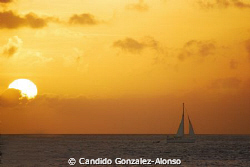 Back from Bonaire sunsets and sailboats lost in the horrizon by Candido Gonzalez-Alonso