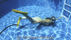 My 10 year old daughter in the backyard pool with some of... by Michael Grebler