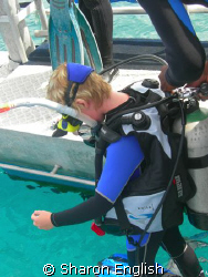 My 12 year old daughter on her very first open water dive... by Sharon English