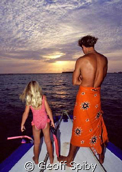 My daughter ready and waiting for an evening snorkel by Geoff Spiby