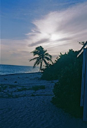 Sunset on the West side of Grand Cayman, about a mile sou... by Mordechai Saxon