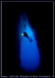 Diver (my wife) in the cave of the Inland Sea in Gozo :O)... by Michel Lonfat