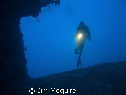 A Martin Patrol Plane on the bottom of the Kwajalein Lago... by Jim Mcguire