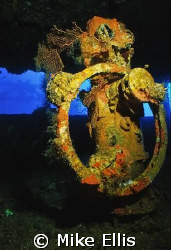 The helm of the Nippo Maru in Truk lagoon. Nikonos V w/ 1... by Mike Ellis