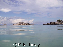 Surfacing to a millpond sea with an almost cartoon panora... by Kirk Murray