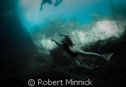 Swimmer beware!  There be monsters here... by Robert Minnick