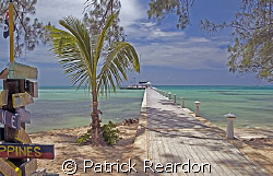 Boat readies to leave the dock at Rum Point for the trip ... by Patrick Reardon