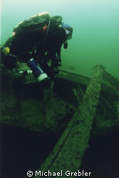 """Rebreather diver on the wreck of the hospital ship """"Letit... by Michael Grebler"""
