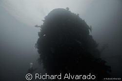 Bow of the Shinkoku Maru with dive buddy.  Ship sunk by A... by Richard Alvarado