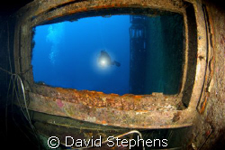 Shot of a diver on the wreck of the Zenobia. Taken with a... by David Stephens