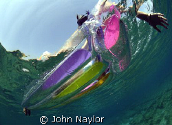 girl on a lilo. by John Naylor