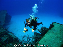 Wendy photographing a Sunken Destroyer in Cayman Brac. C... by Kevin Robert Panizza