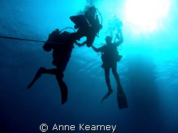 5 meters stop, holding on a rope because of the current t... by Anne Kearney