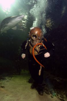 Diving with historical equipment . Just a case of balanci... by Steve Baillie