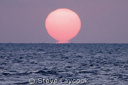 Sunrise - proof that the sun is melting and heating up th... by Steve Laycock