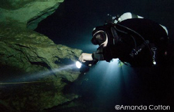 "Cave diver next to the infamous ""Big E"" in Hole in the Wa... by Amanda Cotton"