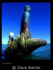 a statue to the engineer who built a pipeline from sea to... by Dave Baxter