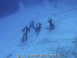 Diver photographing a ray with a curious fish using Olymp... by J. Daniel Horovatin