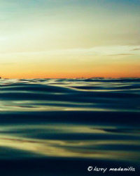 Golden hour.. taken right after a late afternoon dive. Ba... by Larry Medenilla