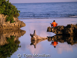 A young boy reflects. Roatan Honduras. by Tom Mcmillen