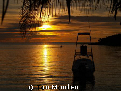 Sunset on the westend Island of Roatan, at a little bar c... by Tom Mcmillen
