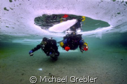 Ice Divers using cave techniques at the start of their di... by Michael Grebler