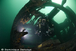 Rebreather diver coming out of the Robert Gaskin wreck, S... by Dominique Danvoye