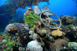 Pic of a truck shot on top of a wreck sunk in Truk Lagoon. by Ken Thate