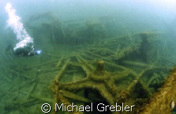 A diver points to the rocker beam of the passenger sidewh... by Michael Grebler