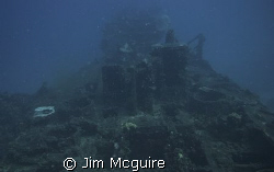 The left side of this wreck off Shell Island in the Kwaja... by Jim Mcguire