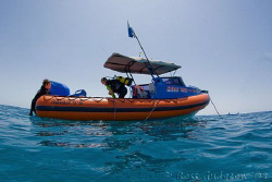 The End!  My dive buddies getting back into our boat at t... by Ross Gudgeon