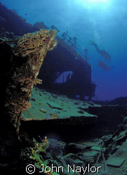 divers on wreck of carnatic. by John Naylor