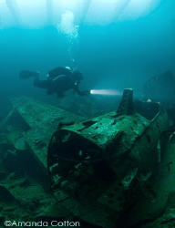 Diver above Japanese Zero inside cargo hold of Fujikawa M... by Amanda Cotton