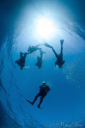 After the dive, go into the light. But, which direction? :-) by Michael Henke