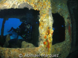 Eduardo Nadal exploring the interiors of the RMS Rhone, S... by Abimael Márquez