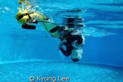 Sea kayak rolling demonstration in a pool. by Kyung Lee