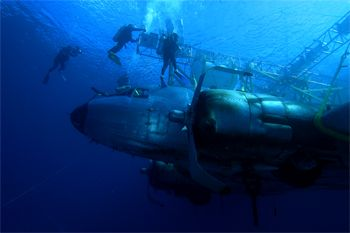 sinking a plane wreck for a new movie, nikon D100,sea&sea... by Leon Joubert