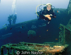 divers on xenobia wreck by John Naylor