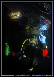 """""""Touching the ice"""" - Night fall dive under the Ice. Faby ... by Michel Lonfat"""